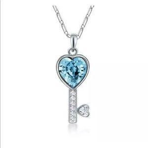 Silver key necklace w/ blue heart shaped stone